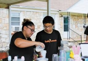 """Andee Guerra and her son Andres """"Buddy"""" Guerra-Thorton make lemonade at Buddy's Lemonade stand in Del City. The family started the stand to raise money to help Buddy's grandmother who is battling cancer. Photo by Anthony Thomas"""