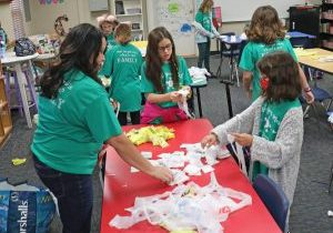 Members of the Comp Club at Schwartz Elementary School work on making mats out of recycled plastic bags. (Photo by Jeff Harrison)
